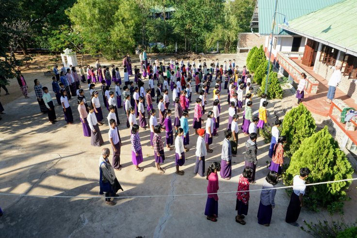 "Assembly in the yard of the ""Light of Love"" School"